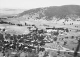 Picture relating to Acton - titled 'Ariel View. Canberra Community Hospital and Acton from the air. Black Mountain in background.'