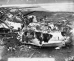 Picture relating to Canberra - titled 'Aircraft crash showing engine - Single seat Scout Experimenter prefix A2 crashed at the opening of Parliament on 9 May 1927 on Rottenbury Hill at the site of St Marks Church, Blackall Street, Barton - Pilot Flying Officer EWEN was killed and is buried in St John's churchyard - See Canberra Times 13 May 1927 for details.'