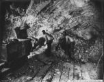 Picture relating to Mount Morgan - titled 'Miners at work at the Linda Mine, Mount Morgan, ca. 1909'