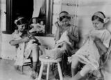 Picture relating to Toowong - titled 'Three sisters doing needlework on the verandah of their Toowong home, ca. 1918'