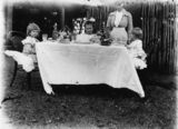 Picture relating to Marlborough - titled 'Children's afternoon tea party in a garden, Marlborough, 1900-1910'
