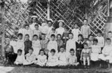 Picture relating to Coorparoo - titled 'Matron, sisters and children at the Queen Alexandra Home, Coorparoo, Brisbane, Queensland, ca. 1913'