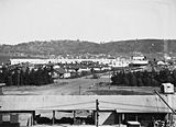 Picture relating to Kingston - titled 'Kingston from industrial area near intersection of Giles Street and Wentworth Avenue .'