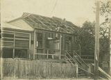 Picture of / about 'Innisfail' Queensland - Repairing the roof of the Innisfail Post Office after the cyclone