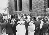 Picture relating to Red Hill - titled 'Laying the Foundation Stone for the Canberra Church of England Boys Grammar School Flinders Way, Red Hill- Clergy and speakers.'