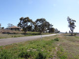 Picture relating to Breeza - titled 'Kamilaroi Hwy at eastern end of Breeza'