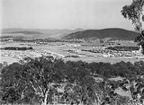 Picture relating to Ainslie - titled 'Reid, Braddon and Civic Centre from Mt Ainslie. Ainslie Hotel, Limestone Avenue on right, Black Mountain at the rear.'