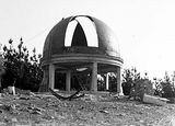 Picture relating to Mount Stromlo - titled 'Construction, Mount Stromlo showing partially completed observatory dome.'