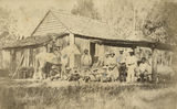 Picture relating to Beenleigh - titled 'Workers posing outside a building on the Yellowwood Sugar Plantation, Albert River, Beenleigh, ca. 1875'