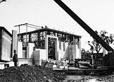Picture relating to Acton - titled 'Australian Institute of Anatomy under construction, external facing being fitted. McCoy Circle, Acton.'