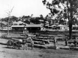 Picture relating to Alderley - titled 'View of Alderley Railway Station, Brisbane, with Poultney's Sawmill Yards in the foreground, ca. 1925'