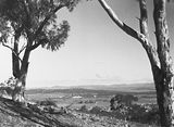 Picture relating to Ainslie - titled 'Old Parliament House from Mt Ainslie. St. Johns Church in front.'