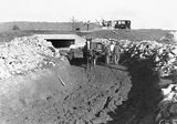 Picture relating to Acton - titled 'Culvert and drain under construction at Sullivans Creek, Acton.'