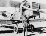 Picture relating to Queensland - titled 'Lieutenant Balderson pictured standing in front of an aeroplane'