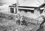Picture relating to Currumbin - titled 'Man and woman in the front yard at Currumbin Beach, 1952'
