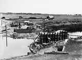 Picture relating to Molonglo River - titled 'Scotts Crossing over the Molonglo River under construction looking south showing Molonglo camp and Blundells Cottage'