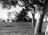 Picture relating to Yarralumla - titled 'Government House from the south showing trees. Governor-General's Residence. Yarralumla.'