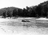 Picture relating to Murrumbidgee River - titled 'Murrumbidgee River at Uriarra showing a raft made of four barrels'