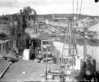 Picture relating to Molonglo River - titled 'Excavation workings - Sewerage mains, under the Molonglo River. Hotel Canberra (background) and Commonwealth Bridge (right).'