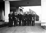 Picture relating to Yarralumla - titled 'Scullin 16th Ministry, Labor Cabinet at entrance to Government House, Yarralumla for swearing in.'