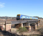 Picture relating to Burbong - titled 'Burbong Bridge - CountryLink train to Canberra'