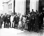 Picture relating to Parliament House - titled 'Visit to Canberra by Young Australia League boys from Western Australia. Officials in front of Old Parliament House.'