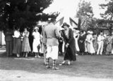 Picture relating to Isaacs - titled 'Group of spectators at opening of new Golf Club House. Lady Isaacs wife of the Govenor General with the club.'