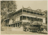 Picture relating to Currumbin - titled 'Official cars arriving at the Hotel Currumbin, Queensland, ca. 1927'