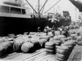 Picture relating to Brisbane - titled 'Loading bales of wool at the Nixon Smith Wharves, Brisbane, 1924'