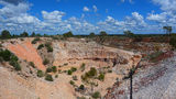Picture relating to Lightning Ridge - titled 'Looking down into the pit of the Lunatic Hill Open Cut Opal Mine'