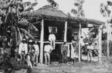 Picture relating to Mackay - titled 'South Sea Islanders standing in front of a house in Mackay in 1907'