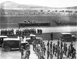 Picture relating to Parliament House - titled 'Royal Visit, May 1927 - Outside Old Parliament House showing Army band, Navy and Army formations and boy scouts during rehearsal.'
