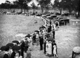 Picture relating to Stanthorpe - titled 'Parked cars and a section of the crowd at the Stanthorpe Showgrounds in February, ca. 1932'