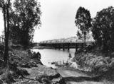 Picture relating to Bundaberg - titled 'Burnett River Bridge from North Bundaberg, ca. 1935'