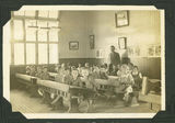 Picture relating to Ayr - titled 'Teacher and students in a primary classroom in Ayr possibly Ayr State School, 1937'