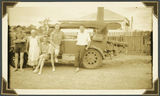Picture relating to Ipswich - titled 'Mrs Fraser photographed with travellers, Ipswich, 1937'