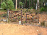 Picture relating to Chichester Range - titled 'Rustic Gates in the Jarrah Forest (architecture)'