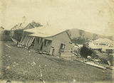 Picture relating to Innisfail - titled 'Damaged cottages in Geraldton after the 1906 cyclone'