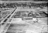 Picture relating to Canberra - titled 'Ariel view over Commonwealth Bridge looking south showing Albert Hall, Hotel Canberra and West Block (negative reversed).'
