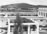 Picture relating to Canberra - titled 'View to west from Old Parliament House courtyard. Hotel Canberra and Albert Hall in centre, Black Mountain in background.'