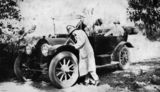 Picture relating to Queensland - titled 'Three men attending to a 1912 Cadillac motor vehicle'