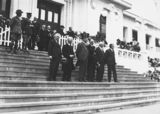 Picture relating to Lyons - titled 'Anzac Day 1933, Prime Minister Hon J. A. Lyons, Leader of the Opposition, Hon J. A. Scullin and members on front steps of Old Parliament House.'