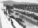 Picture relating to Parliament House - titled 'Anzac Day 1933. Boy Scouts marching past the Govenor General Sir Isaac Isaacs in front of Old Parliament House.'