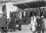 Picture relating to Canberra - titled 'Royal Visit, May 1927 - Canberra citizens passing the Royal Party on the front steps on Old Parliament House at the Civic Reception.'