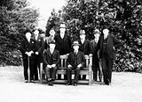Picture of / about 'Isaacs' the Australian Capital Territory - Meeting of the Executive Council at Government House, Yarralumla. Seated, Prime Minister Joe Lyons and Governor General Sir Isaac Isaacs, Standing includes Archdale, Parkhill, Bracegirdle, Finlay, Starling.